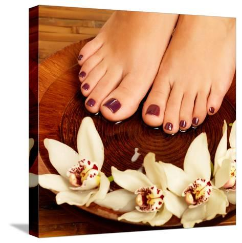 Female Feet at Spa Salon on Pedicure Procedure-Valua Vitaly-Stretched Canvas Print