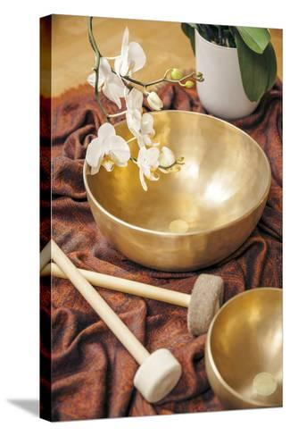 An Image of Some Singing Bowls and a White Orchid-magann-Stretched Canvas Print