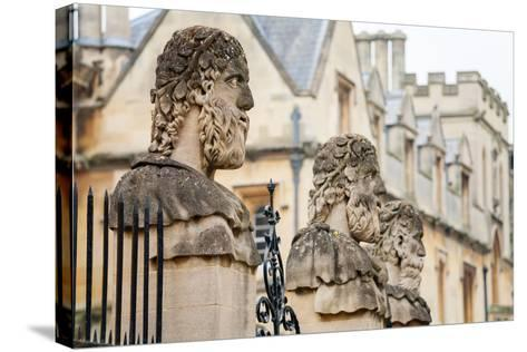 Sheldonian Statues. Oxford,  England-Arsty-Stretched Canvas Print