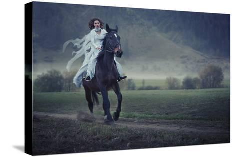Sensual Young Beauty Riding a Horse-conrado-Stretched Canvas Print