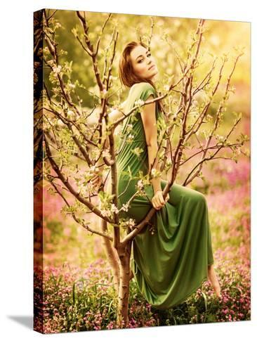 Fairy-Tail Forest Nymph, Beautiful Sexy Woman at Spring Garden, Wearing Long Dress, Sitting on Bloo-Anna Omelchenko-Stretched Canvas Print