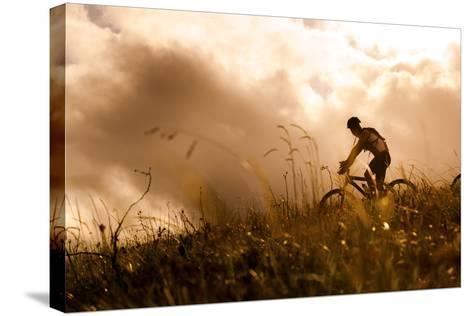 Happy Couple Riding Bicycles Outside, Healthy Lifestyle Fun Concept. Silhouette at Sunset Panoramic-warrengoldswain-Stretched Canvas Print