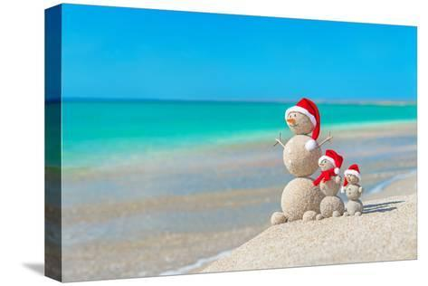Snowmans Family at Sea Beach in Santa Hat. New Years and Christmas-EMprize-Stretched Canvas Print