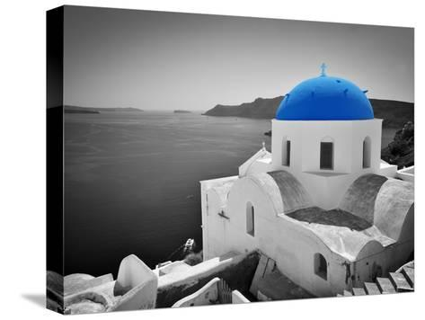 Oia Town on Santorini Island, Greece. Black and White Styled with Blue Dome of Traditional Church O-Michal Bednarek-Stretched Canvas Print