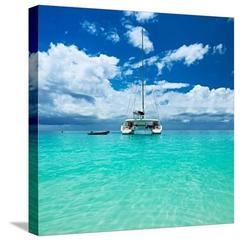 Beautiful Beach with Boat at Seychelles, Praslin, Anse Lazio-haveseen-Stretched Canvas Print