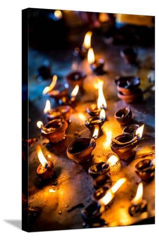 Burning Candles in the Indian Temple during Diwali, The Festival of Lights-Andrey Armyagov-Stretched Canvas Print