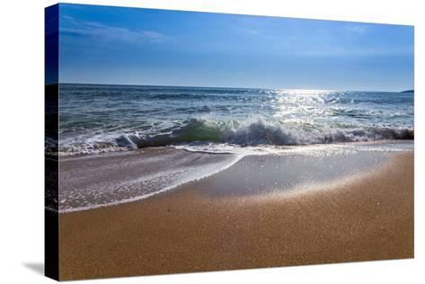 Sand Sea Beach and Blue Sky after Sunrise and Splash of Seawater with Sea Foam and Waves-fototo-Stretched Canvas Print