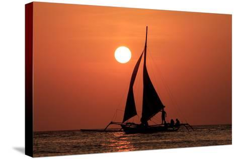 Sailing Boat at Sunset on Sea-Rich Carey-Stretched Canvas Print