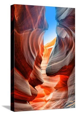 Sunlight Reflected off of the Red Rock Curves of the Antelope Canyon Slot Canyons in Page, Arizona.-lucky-photographer-Stretched Canvas Print