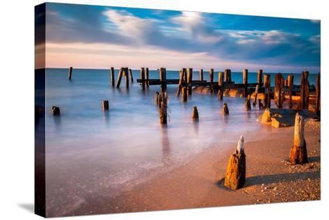 Long Exposure at Sunset of Pier Pilings in the Delaware Bay at Sunset Beach, Cape May, New Jersey.-Jon Bilous-Stretched Canvas Print