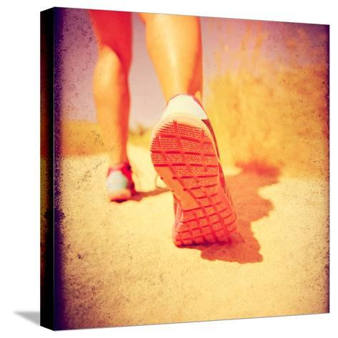 An Athletic Pair of Legs Running or Jogging on a Path during Summer Toned with a Soft Vintage Insta-graphicphoto-Stretched Canvas Print