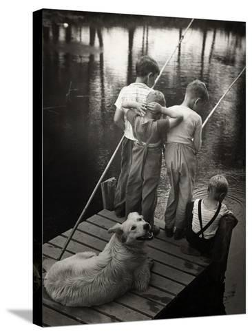 Dogs Supervising Fishing Boys--Stretched Canvas Print