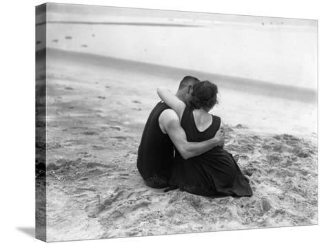 Couple Embracing on Beach--Stretched Canvas Print