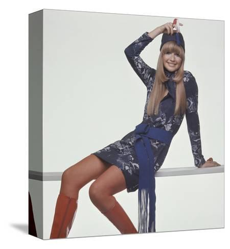 Model, Sitting on Bench, Wears a Blue and White Snake-Print T-Shirt Style Dress-Gianni Penati-Stretched Canvas Print