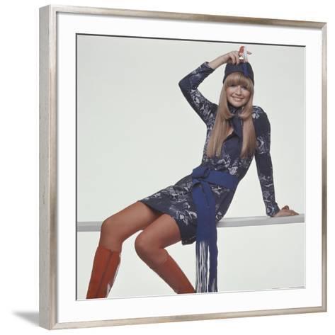 Model, Sitting on Bench, Wears a Blue and White Snake-Print T-Shirt Style Dress-Gianni Penati-Framed Art Print