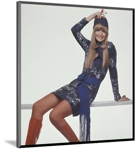Model, Sitting on Bench, Wears a Blue and White Snake-Print T-Shirt Style Dress-Gianni Penati-Mounted Premium Giclee Print