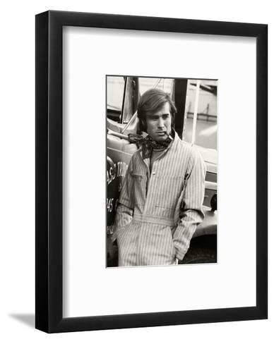 Man in Striped Denim Jumpsuit and Bandana Leaning Against a Truck with a Cigarette-Bruce Weber-Framed Art Print
