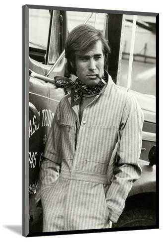 Man in Striped Denim Jumpsuit and Bandana Leaning Against a Truck with a Cigarette-Bruce Weber-Mounted Premium Giclee Print