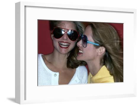 Close-Up on Two Models with Smiles, a Pair of Red Plastic Bon-Lon Sunglasses by Bonneau-Jacques Malignon-Framed Art Print
