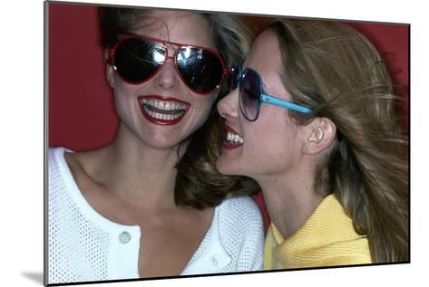 Close-Up on Two Models with Smiles, a Pair of Red Plastic Bon-Lon Sunglasses by Bonneau-Jacques Malignon-Mounted Premium Giclee Print