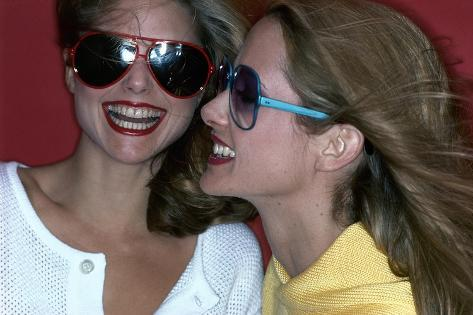 Close-Up on Two Models with Smiles, a Pair of Red Plastic Bon-Lon Sunglasses by Bonneau-Jacques Malignon-Stretched Canvas Print
