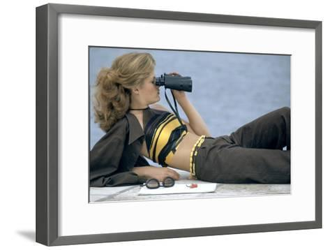 Model Is Reclining Wearing Brown Pant Suit with Yellow and Brown Halter by Ken Scott-Gianni Penati-Framed Art Print