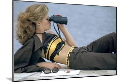Model Is Reclining Wearing Brown Pant Suit with Yellow and Brown Halter by Ken Scott-Gianni Penati-Mounted Premium Giclee Print
