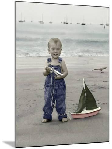 Little Kid on Beach with Toy Sailboat-Nora Hernandez-Mounted Giclee Print