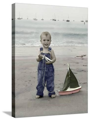 Little Kid on Beach with Toy Sailboat-Nora Hernandez-Stretched Canvas Print