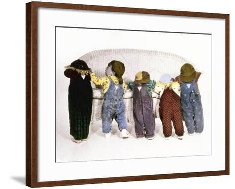 Five Babies Leaning on Couch with Backs to Us-Nora Hernandez-Framed Art Print