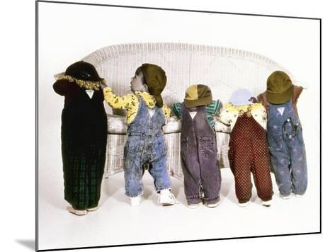 Five Babies Leaning on Couch with Backs to Us-Nora Hernandez-Mounted Giclee Print
