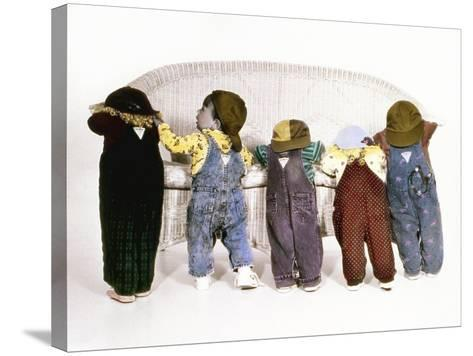 Five Babies Leaning on Couch with Backs to Us-Nora Hernandez-Stretched Canvas Print