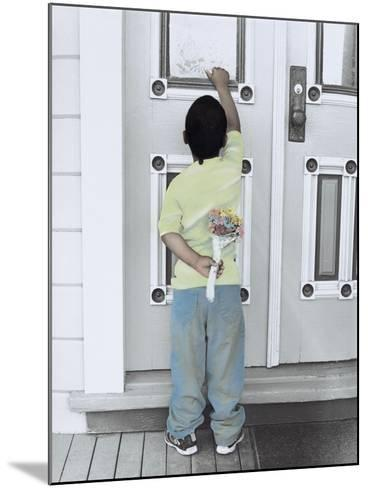 Boy Holding a Bouquet of Flowers Behind His Back While Knocking on the Door-Nora Hernandez-Mounted Giclee Print
