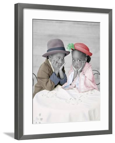Boy and Girl Sitting at Table with Head in Hands-Nora Hernandez-Framed Art Print