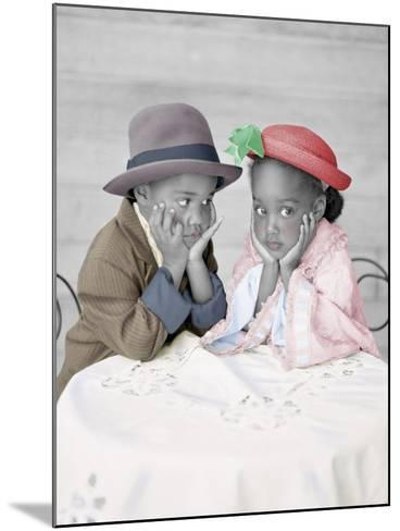 Boy and Girl Sitting at Table with Head in Hands-Nora Hernandez-Mounted Giclee Print