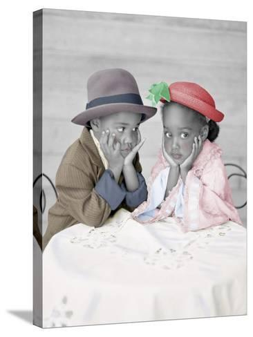 Boy and Girl Sitting at Table with Head in Hands-Nora Hernandez-Stretched Canvas Print