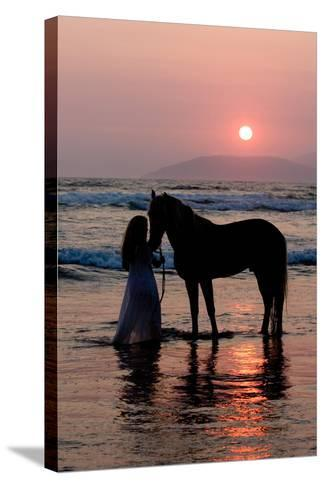 Girl with a Horse in the Water at Sunset-Nora Hernandez-Stretched Canvas Print