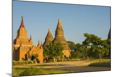 Myanmar. Bagan. Red Brick Temple Glows in the Late Afternoon Light-Inger Hogstrom-Mounted Photographic Print