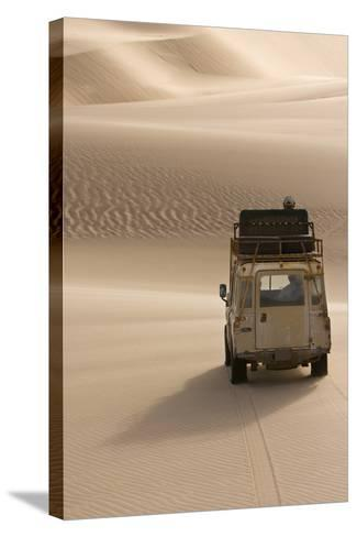 Skeleton Coast, Namibia. Land Rover Venturing Out over the Sand Dunes-Janet Muir-Stretched Canvas Print