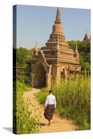 Myanmar. Bagan. Htilominlo Temple. Man Walking Towards the Temple Gate-Inger Hogstrom-Stretched Canvas Print