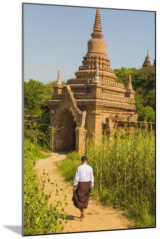 Myanmar. Bagan. Htilominlo Temple. Man Walking Towards the Temple Gate-Inger Hogstrom-Mounted Photographic Print