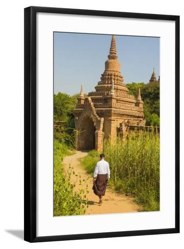 Myanmar. Bagan. Htilominlo Temple. Man Walking Towards the Temple Gate-Inger Hogstrom-Framed Art Print