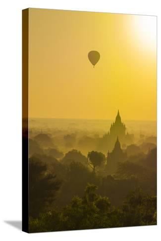 Myanmar. Bagan. Hot Air Balloons Rising over the Temples of Bagan-Inger Hogstrom-Stretched Canvas Print