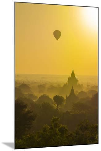 Myanmar. Bagan. Hot Air Balloons Rising over the Temples of Bagan-Inger Hogstrom-Mounted Photographic Print