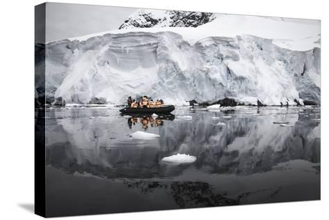 Antarctica. Tourists Looking at a Glacier from a Zodiac-Janet Muir-Stretched Canvas Print