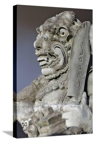 Stone Statue at Entrance of Tanah Lot. Bali Island, Indonesia-Keren Su-Stretched Canvas Print