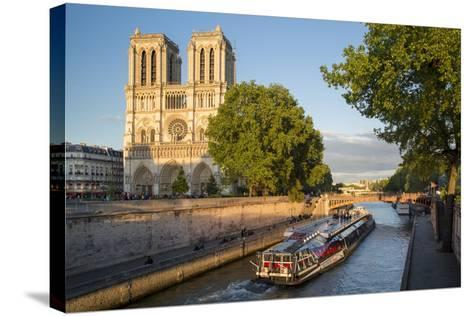 Cruise Barge, River Seine, and Cathedral Notre Dame, Paris, France-Brian Jannsen-Stretched Canvas Print