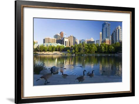 Canada Geese Resting at a Lake with Skyline, Calgary, Alberta, Canada-Peter Adams-Framed Art Print