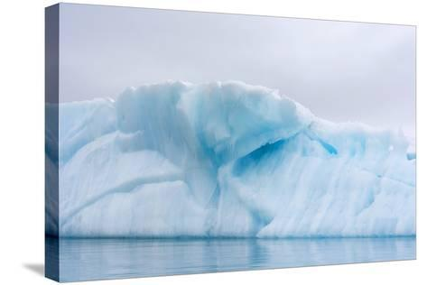 Norway. Svalbard. Brasvelbreen. Turquoise Ice Bergs in the Calm Water-Inger Hogstrom-Stretched Canvas Print