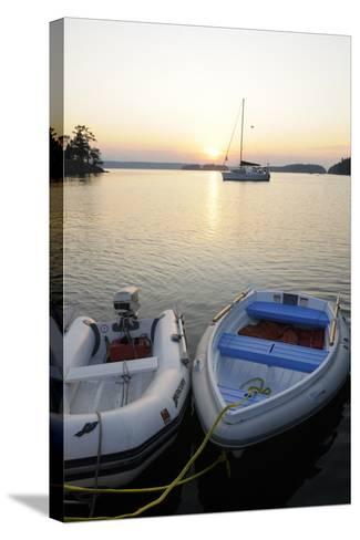 Canada, B.C., Gulf Islands, Wallace Island. Two Dinghy's at Sunset-Kevin Oke-Stretched Canvas Print